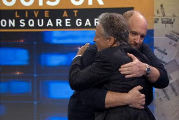 Louis CK hugging Jon Stewart during the Aug. 6 The Daily Show