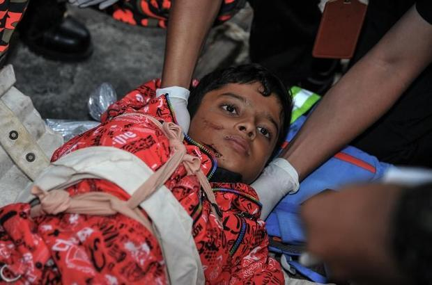 Members of Malaysian rescue team attending to an injured Singaporean student after an earthquake in ...