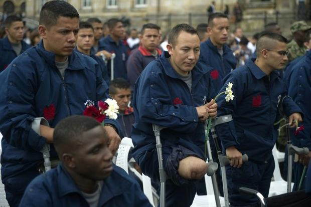 Colombian soldiers maimed by landmines attend a ceremony in Bogota for the UN International Day for ...