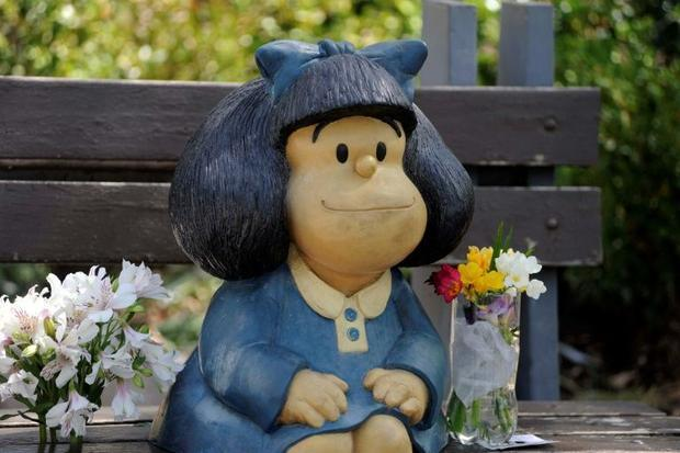 Flowers left by members of the public at a statue of Mafalda in Buenos Aires  after the announcement...