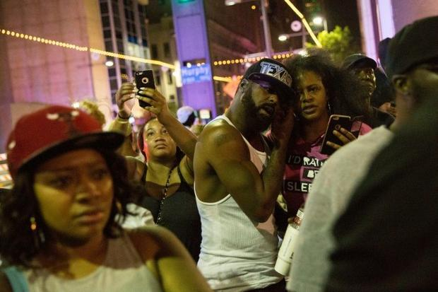 Hundreds gathered in Dallas to protest against the fatal shootings of two black men by police in Lou...