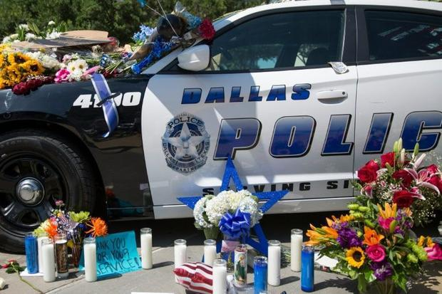 Flowers and candles adorn a memorial outside the Dallas Police Headquarters on July 8  2016
