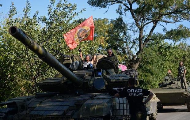 Pro-Russian fighters sit on top of a tank in Starobesheve  southeast of Donetsk  on August 31  2014