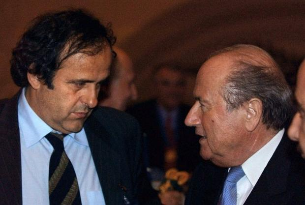 World body FIFA bans president Sepp Blatter (R) and vice president Michel Platini (L) for eight year...