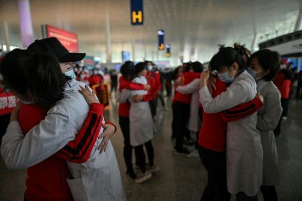 As the airport in Wuhan reopened on April 8  medical staff from Jilin Province (in red) embraced nur...