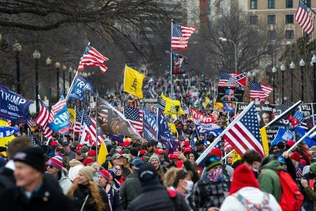 Thousands of supporters of US President Donald Trump march through the streets of Washington en rout...