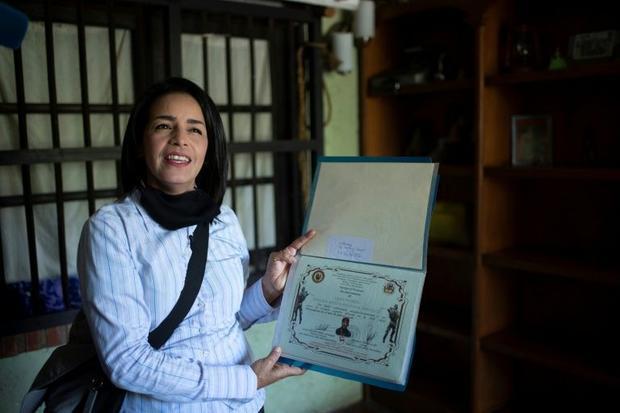 Ismaira Figueroa  a sniper for the Bolivarian militia in Venezuela  keeps a folder with her diplomas...