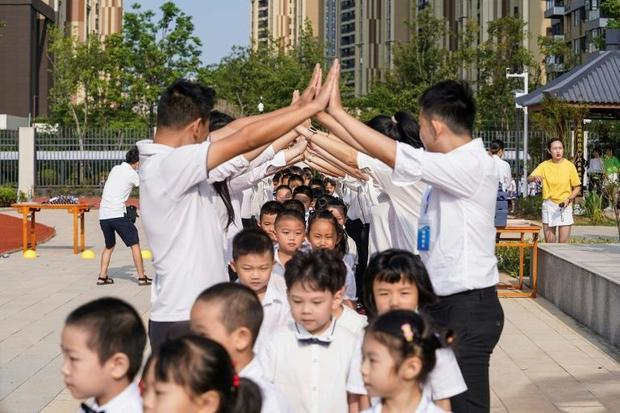 Teachers gave pupils an honour guard as they arrived at school in Wuhan for the first time in seven ...