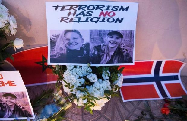 Flowers  pictures and flags in tribute to two young Scandinavian women killed while hiking in Morocc...