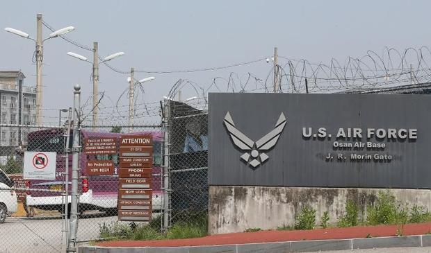 As many as 22 people in South Korea and four US lab workers may have been exposed to anthrax after t...
