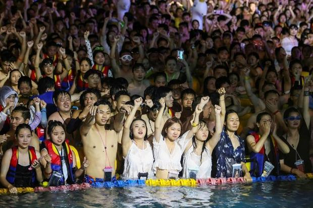 None of the tightly-packed partygoers were seen to be wearing face masks