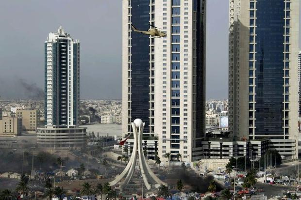 A Bahraini army attack helicopter hovers over Pearl Square in the capital Manama in this file photo ...