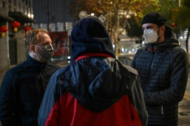 French residents in Wuhan  Remy (L) and Jonathan (R) speak during a interview with AFP about the pos...