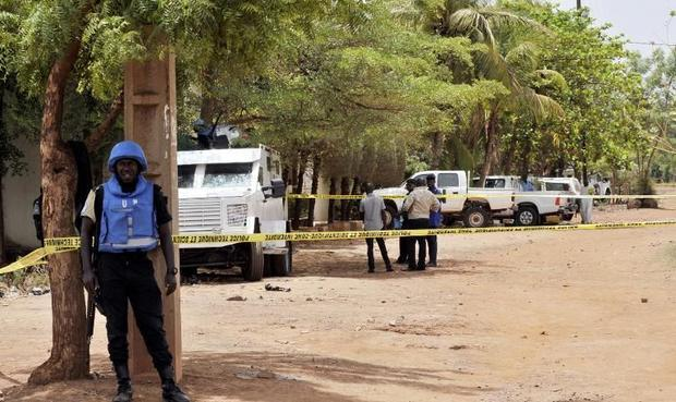 UN peacekeeping solders stand by a cordon set up at the site where a gunman opened fire at a UN resi...