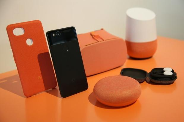 Some analysts say Google  whose connected speakers and handsets are pictured here  is better positio...