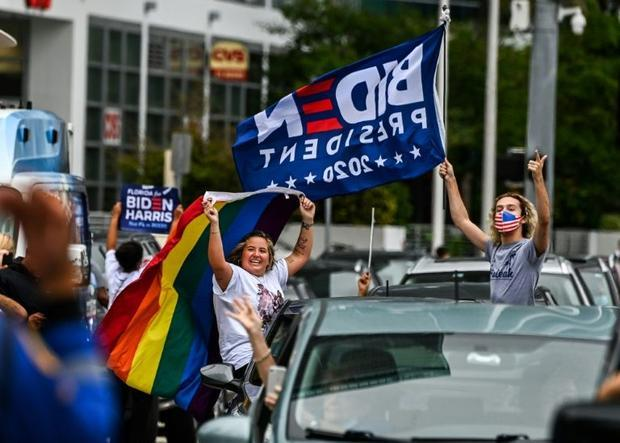There were spontaneous outbursts of  joy after news broke of Joe Biden's win  from New York and...