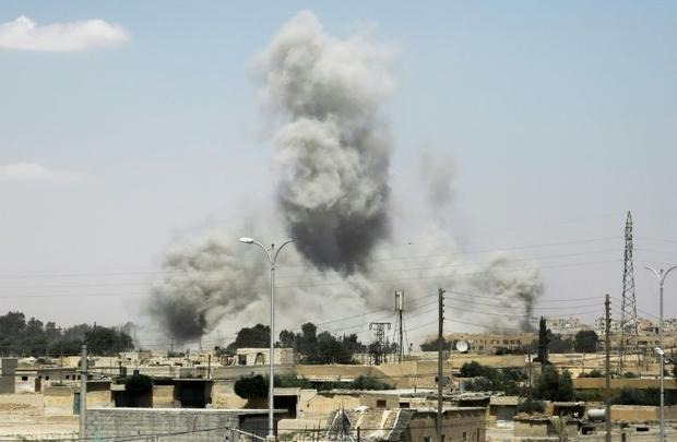 Smoke billows from buildings in the northern Syrian city of Raqa on June 18  2017