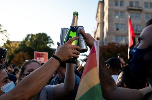 People celebrate Joe Biden's election  on Black Lives Matter plaza across from the White House