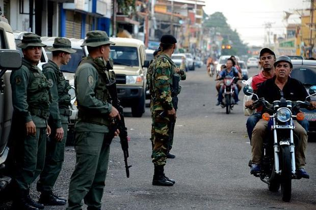 Military checkpoints  such as this one in Tachira pictured in 2016  are commonplace in Venezuela  an...