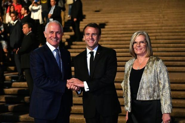 French President Emmanuel Macron  centre  thanked Australian Prime Minister Malcolm Turnbull and his...