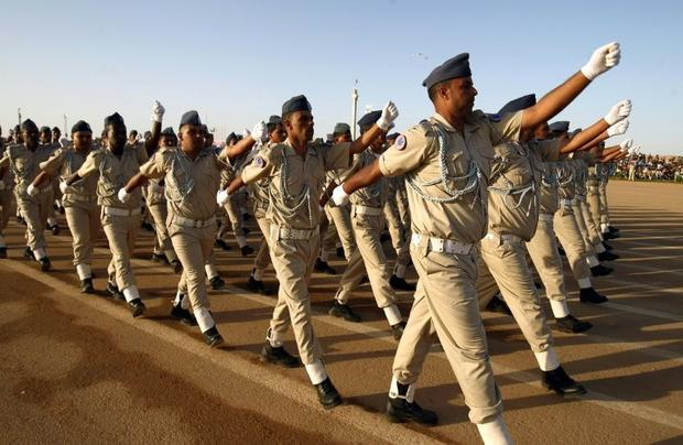 Soldiers from the self-styled army of Khalifa Haftar take part in a military parade in the eastern c...