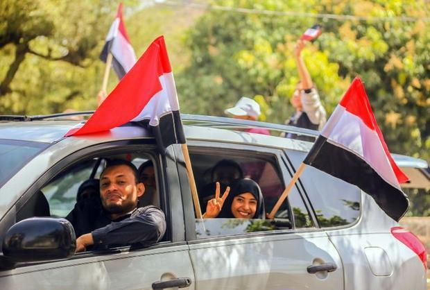 Yemenis celebrate after tribesmen from the Popular Resistance Committees  supporting forces loyal to...