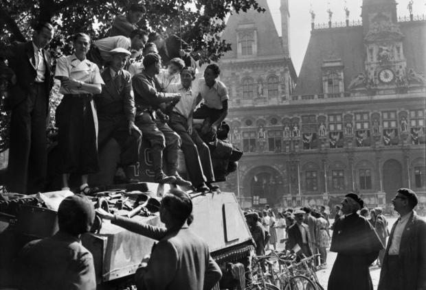 Women clambered onto tanks to offer roses to soldiers and crowds danced in the streets to celebrate ...