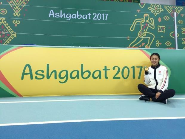 Lui Lai Yiu posing with her gold medal for the women's 60m hurdles during the 2017 Asian Indoor...