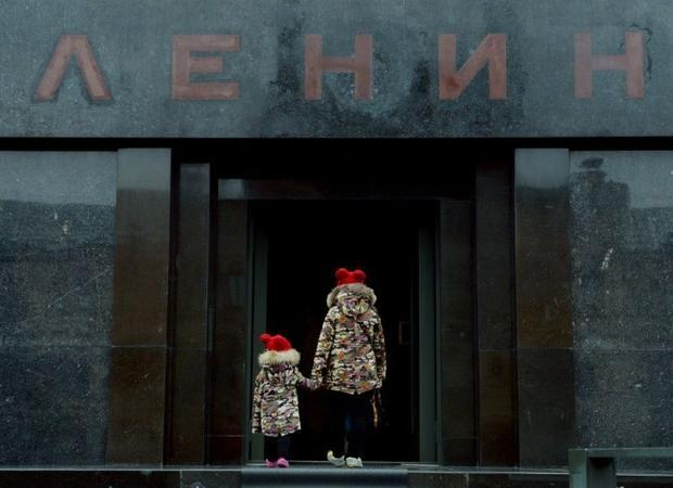 Visitors enter Vladimir Lenin's mausoleum on Red Square in Moscow