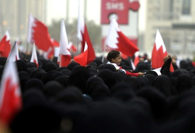 Bahraini Shiite anti-government protesters take part in a rally in remembrance of the seven people w...