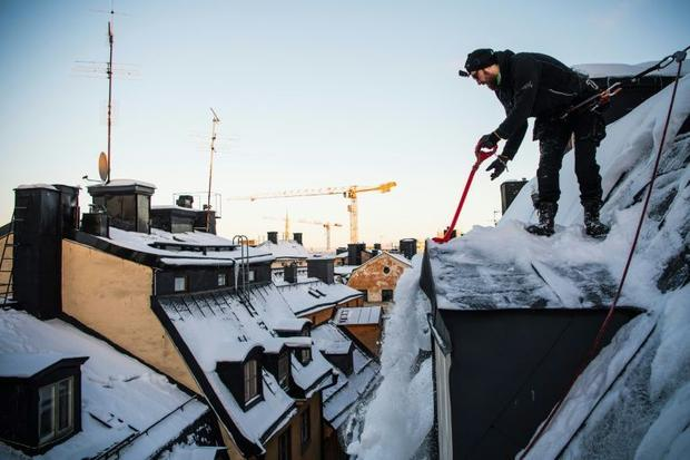 Under Swedish law  property owners are responsible for clearing snow and ice off their buildings if ...