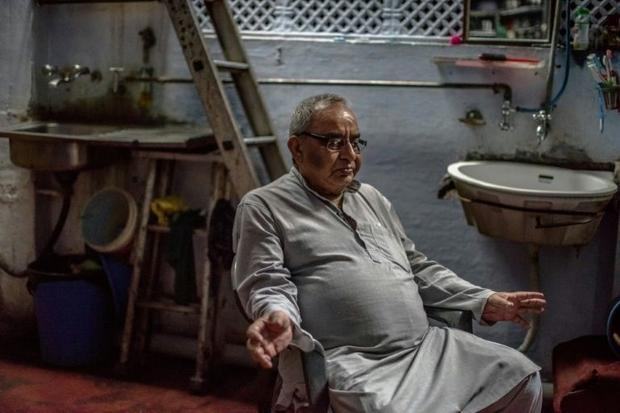 Indian Partition survivor Saleem Hasan Siddiqui  76  speaks during an interview with AFP at the home...