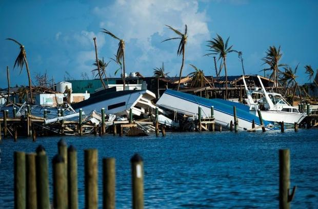 Destroyed boats are pushed up against the pier in the aftermath of Hurricane Dorian in Treasure Cay ...