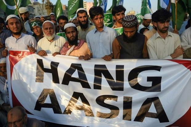 The protests broke out while Khan was in China