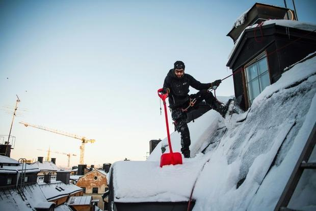 The constant clearing of snow from the city's roofs is first and foremost done for people'...