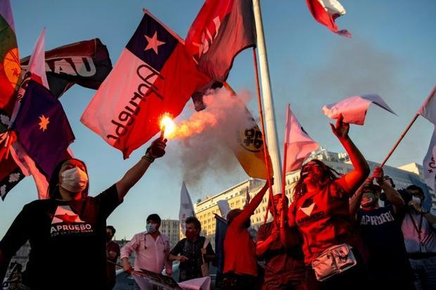 People rally in Santiago in support of amending Chile's constitution ahead of Sunday's ref...