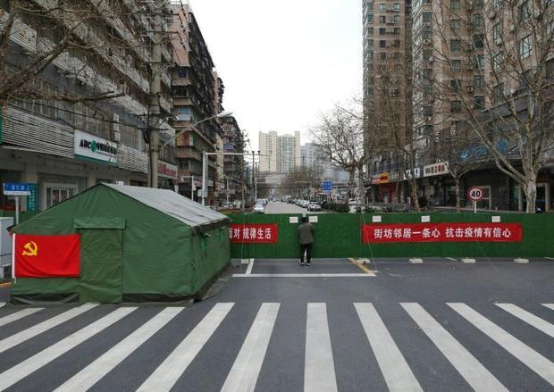 Closing off communities with barriers has split Wuhan into silos