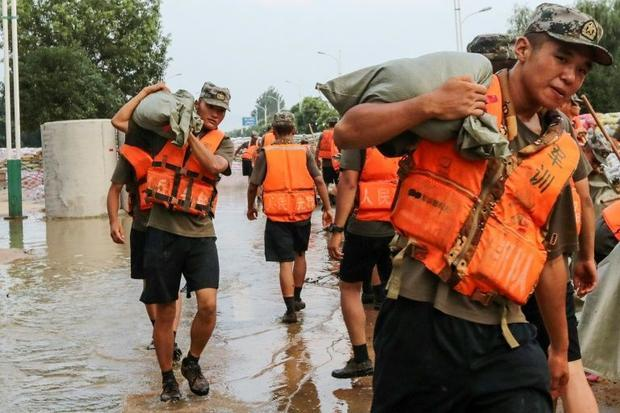 State media reported that more than 100 000 people -- including rescue personnel  soldiers  and ordi...