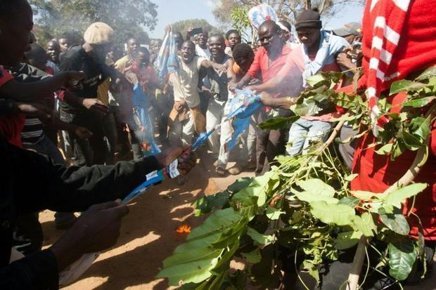 Protesters burns shirts and flags from the recently re-elected Malawian president Arthur Mutharika&a...