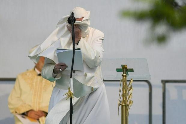 Pope Francis' robe blows in the wind as he delivers a speech during an inter-faith meeting in t...