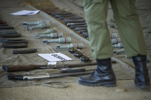 A soldier stands near weapons displayed on September 1  2014 at the Makoanyane Barracks in Maseru  d...