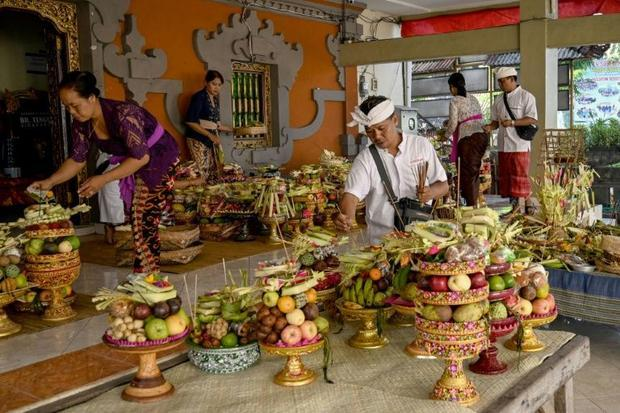 More than 80 percent of Bali's population identify as Hindu and practise a local version of the...