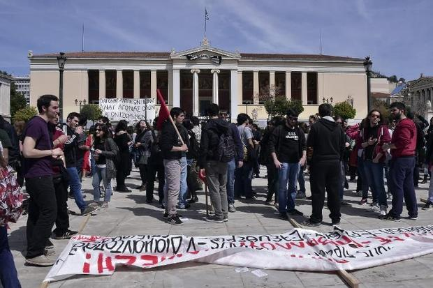 Students gather if front of Athens University occupied by anti-establishment protesters on April 2  ...