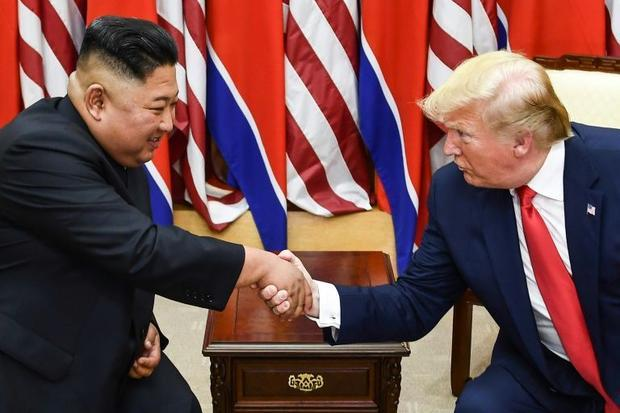 Kim Jong Un and Donald Trump shake hands during a meeting in 2019 on the south side of the Military ...