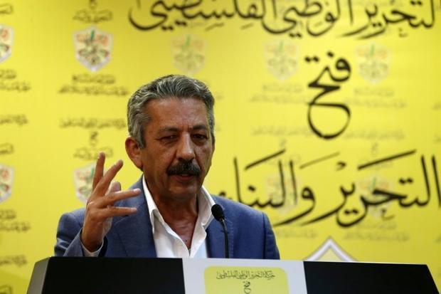 The spokeman of Palestinian President Mahmud Abbas' Fatah movement  Abu al-Haija speaks during ...