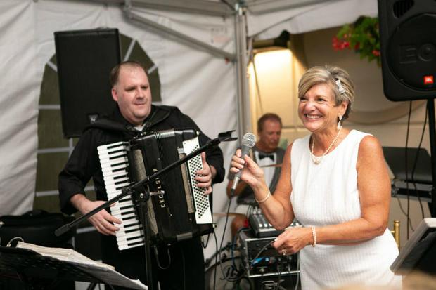 Jean Marie singing and Hank on the drums at 25th wedding anniversary celebration