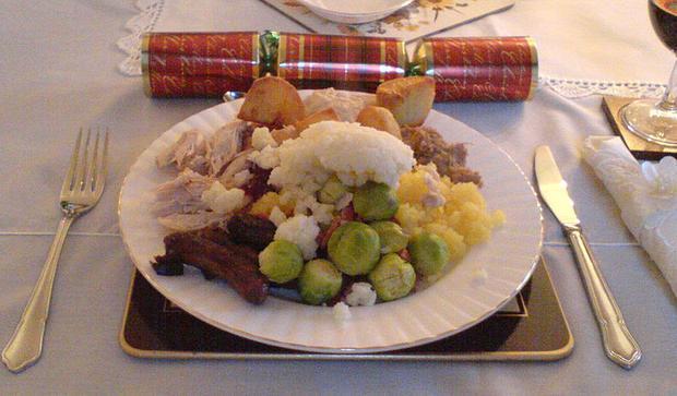 Christmas dinner: a plate of: roast turkey  roast potatoes  mashed potatoes  mashed turnip  chipolat...