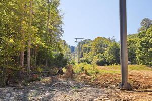 The poles installed up the mountain for the GW Lift at Sugar Mountain moved from the old Summit Expr...