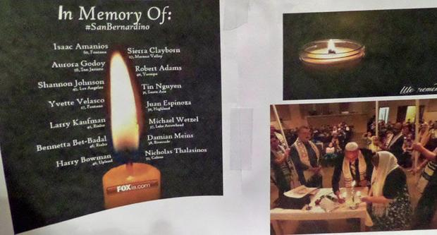 The memorial poster for Nick and Jennifer Thalasinos (pictured lighting Shabat candles) with a candl...