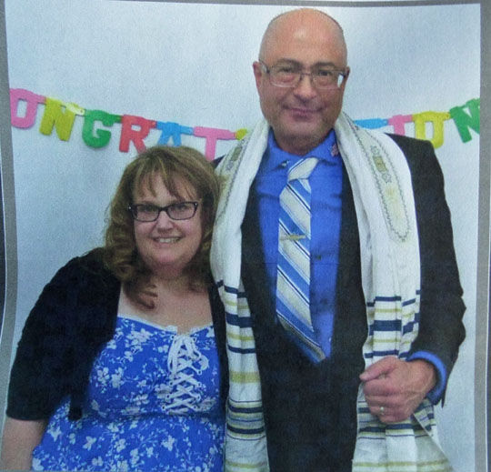 Jennifer and Nick Thalasinos pose toether at Shiloh Messianic Congregation during happier times